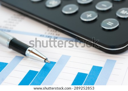 Financial reports and charts - stock photo