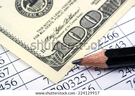 Financial statement, one hundred dollars and pencil closeup - stock photo