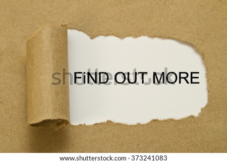 Find out more message written under brown torn paper - stock photo