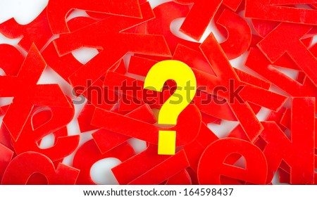 """find """"Question mark"""" in yellow letters on a background of red letter in a jumble or word search puzzle - stock photo"""