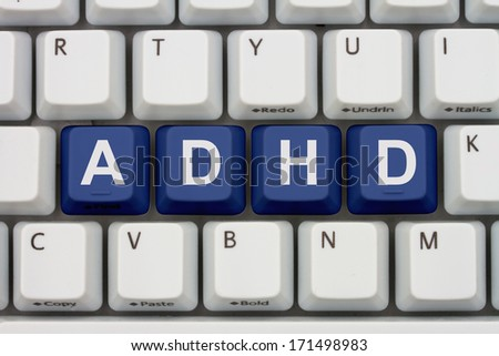 Finding Information about ADHD on the Internet, Computer keyboard keys with word ADHD - stock photo