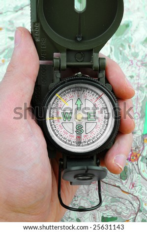 Finding way with compass and map - stock photo