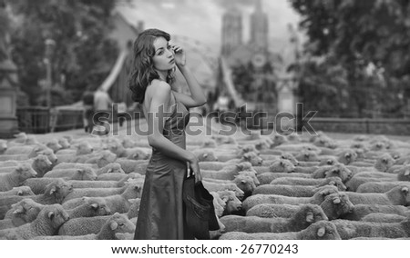 Fine art photo - brunette as a shepherd in an urban scenery - stock photo