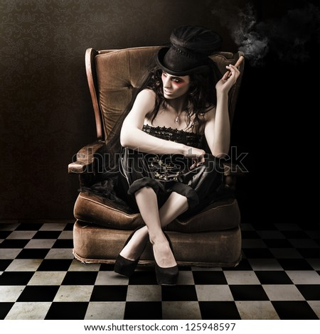 Fine Art Photo Of A Young Fashion Lady Sitting On Vintage Sofa In Grunge Interior - stock photo