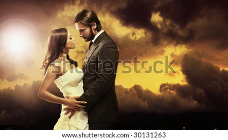 Fine art photo of an attractive wedding couple - stock photo