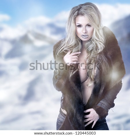 Fine art portrait of a beautiful lady in fur - stock photo