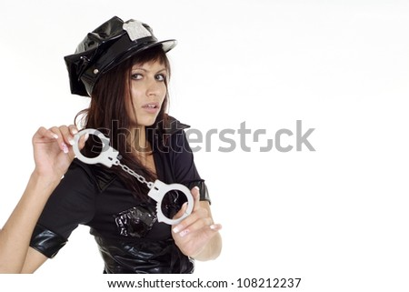 Fine brunette in a suit of police on a white background - stock photo