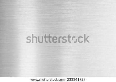 Fine brushed metal with reflective highlight. - stock photo
