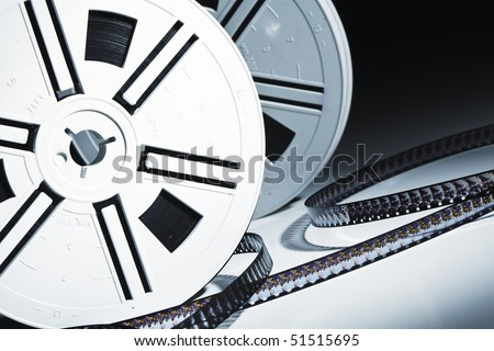 fine closeup image on vintage movie film roll - stock photo
