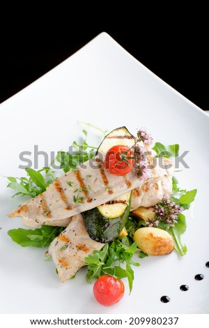 Fine dining / Grilled chicken fillet with fresh vegetables and potato  - stock photo