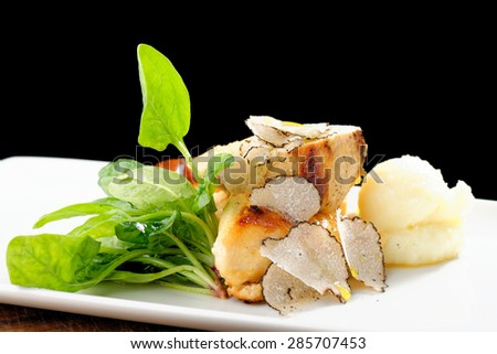 Fine dining mail course, grilled chicken breast with black truffles, quiche and potato purree - stock photo