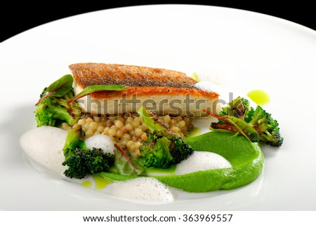 Fine dining, seabass fillet with vegetable - stock photo