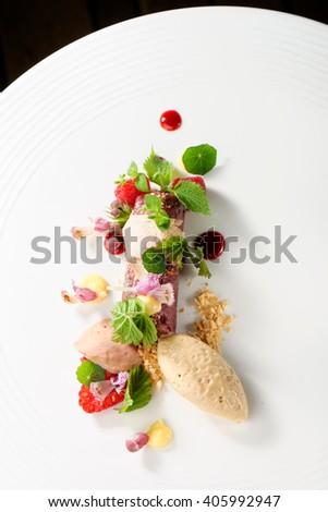 Fine dining, tuna fillet tartare with raspberryes - stock photo