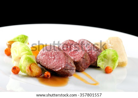 Fine dining, Venison meat steak with vegetable - stock photo