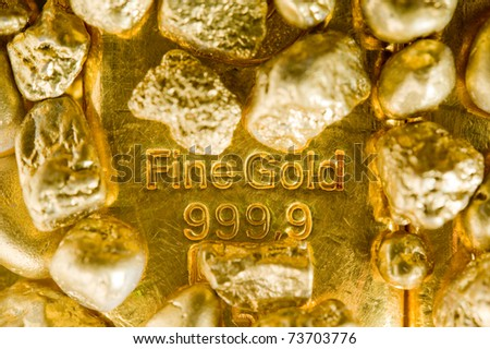 fine gold ingots and nuggets. - stock photo