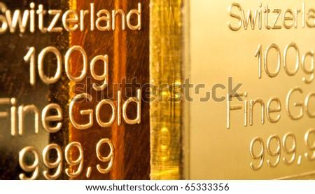 Fine gold ingots background. Closeup. - stock photo