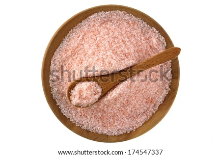 Fine grains of Pink Himalayan salt in a wooden bowl - stock photo