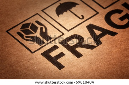 fine image close up of fragile symbol on cardboard selective focus - stock photo