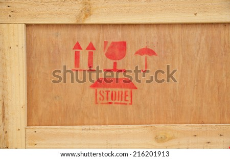 Fine image close-up of fragile symbol on wood board - stock photo