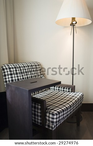 fine image of a chair and lamp in minimalist setting - stock photo