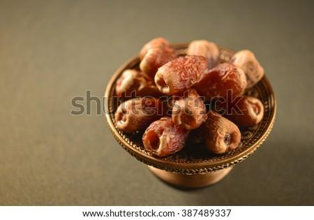 Fine quality arabic dates arranged in an ornamental plate. - stock photo