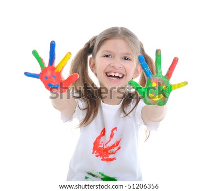 Fine smiling girl with the palms painted by a paint. Isolated on  white background - stock photo