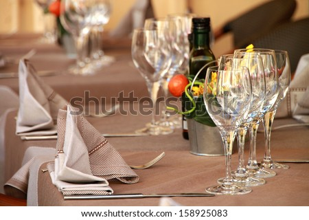 Fine table setting in  restaurant with wineglass for different uses - stock photo