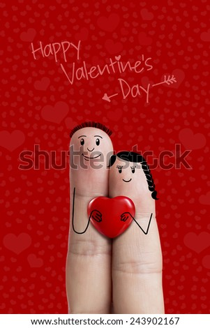 Finger art. Lovers is embracing and holding red heart. A happy couple in love with painted smiley and hugging  - stock photo