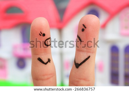 Finger art of a couple during quarrel. A woman yells at a man. - stock photo