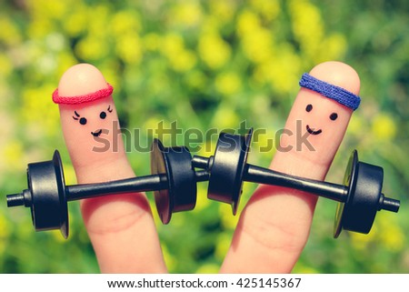 Finger art of a Happy couple. Concept of men and women in sports. - stock photo