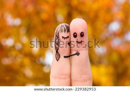 Finger art of a Happy couple. Girl kisses boy on the cheek.  - stock photo
