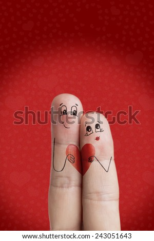 Finger art of a Happy couple. Lovers is embracing and holding heart. There are 4 pathin image. You can easily cut out fingers and title from the background. And insert them into a different scene  - stock photo