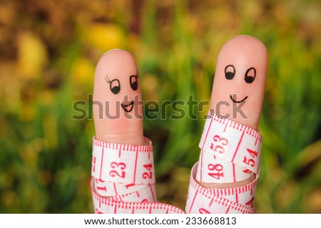 Finger art of a Happy couple with meter. The concept of losing weight together.  - stock photo