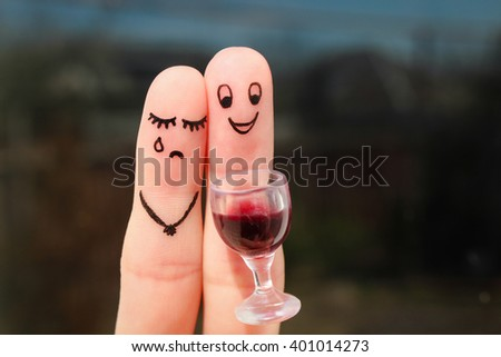 Finger art of couple. Woman is upset because man drunk. - stock photo