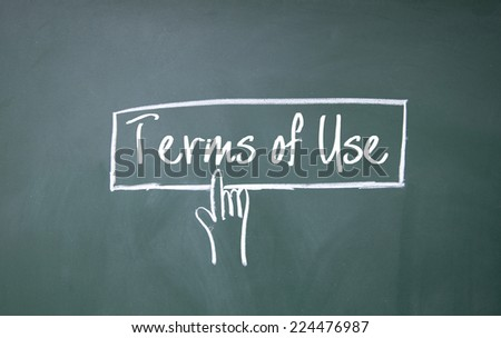 finger click terms of use symbol on blackboard - stock photo