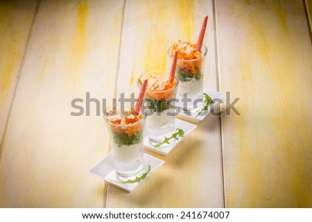 finger food with ricotta arugula carrot and sliced almond - stock photo