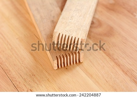 Finger joint at the end of wood sticks (or lumber)- one of woodworking joint - stock photo