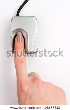 Finger on biometric scanner - stock photo