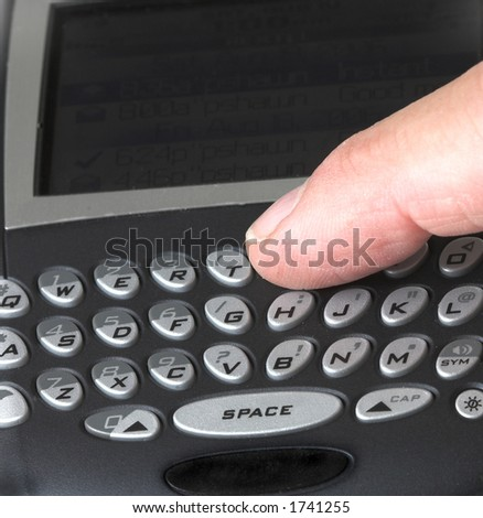 Finger on Blackberry - stock photo