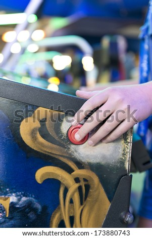 finger on the button, arcade game - stock photo