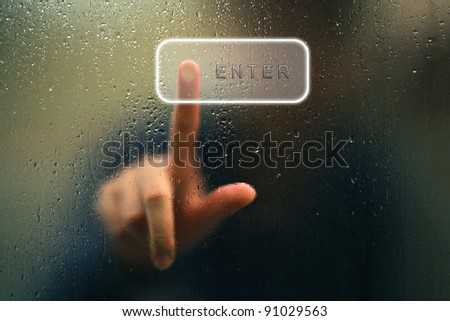 finger point as blur and water drop as abstract style - stock photo