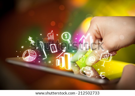 Finger pointing on tablet pc, charts concept - stock photo