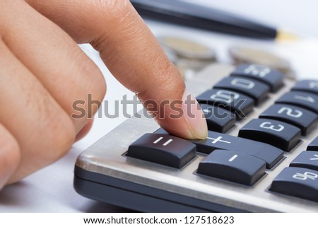 Finger press on plus button calculator (business growing concept) - stock photo