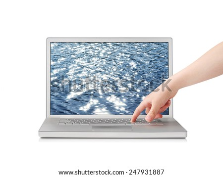 Finger pressing button on notebook with sea screensaver, isolated on white - stock photo