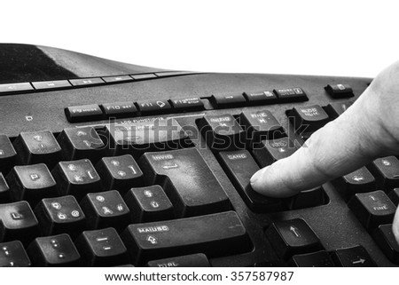 finger pressing the delete key - stock photo