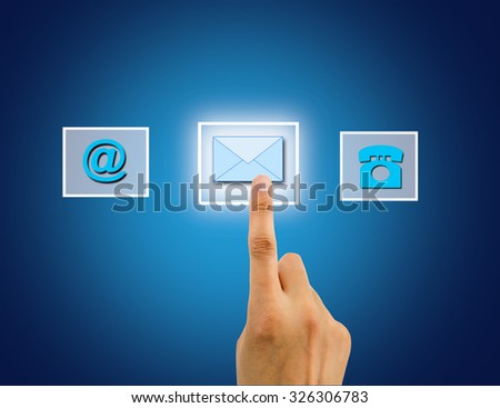 finger pushing button of send an email on the interface - stock photo