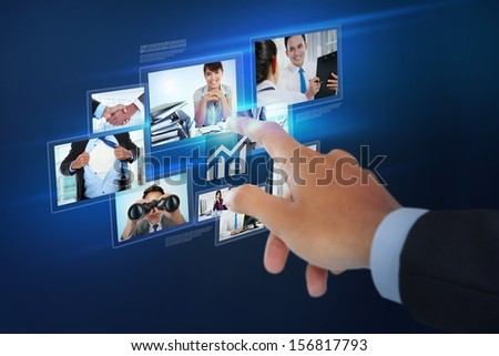 Finger pushing button on a touch screen interface over virtual background - stock photo