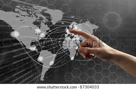 Finger pushing button on a touch screen interface with world map - stock photo