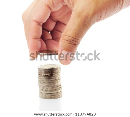 Finger put coin on coin-stack - stock photo