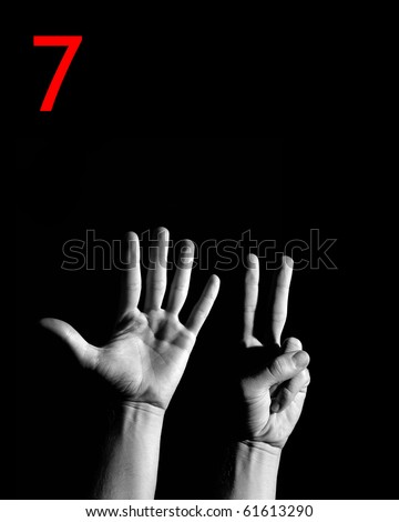 "Finger Spelling the Number ""7"" - stock photo"